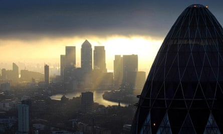 The 'Gherkin' and Canary Wharf at sunrise in the City of London.