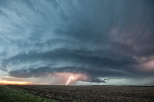Storm cloud formations: a supercell thunderstorm illuminates the sky in Sanford, Kansas. The storm