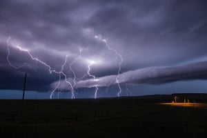 Storm cloud formations: lightning streaks across the sky during an immense storm that produced hail