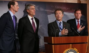 Republican senator Rand Paul speaks as a bipartisan group of senators launch new legislation to rein in the NSA. From left: Democratic senators Ron Wyden and Mark Udall, and on the right, Democrat Richard Blumenthal.