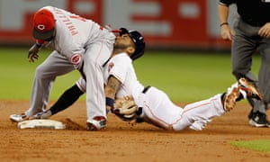 Jonathan Villar of the Houston Astros is tagged out by Brandon Phillips of the Cincinnati Reds