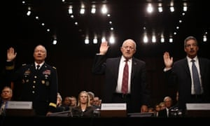 U.S. National Security Agency Director General Keith Alexander (L), Director of National Intelligence James Clapper and Deputy Attorney General James Cole (R) are sworn in to testify at a Senate Intelligence Committee hearing the Foreign Intelligence Surveillance Act legislation on Capitol Hill in Washington, September 26, 2013.