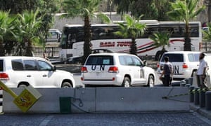 UN vehicles with chemical weapons inspectors