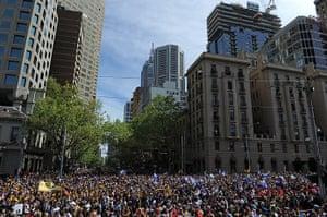 AFL Parade: Hawthorn and Fremantle fans gather on Spring Street