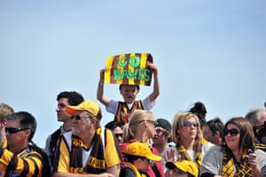 AFL Parade: A young Hawthorn fan holds up a sign
