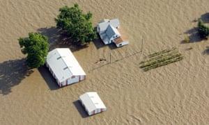 An aerial view of a farm near Rock Port, Missouri submerged in Missouri River flood waters