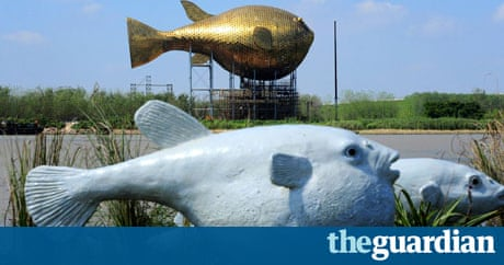 Puffer fish statue reignites row over state decadence in for Giant puffer fish