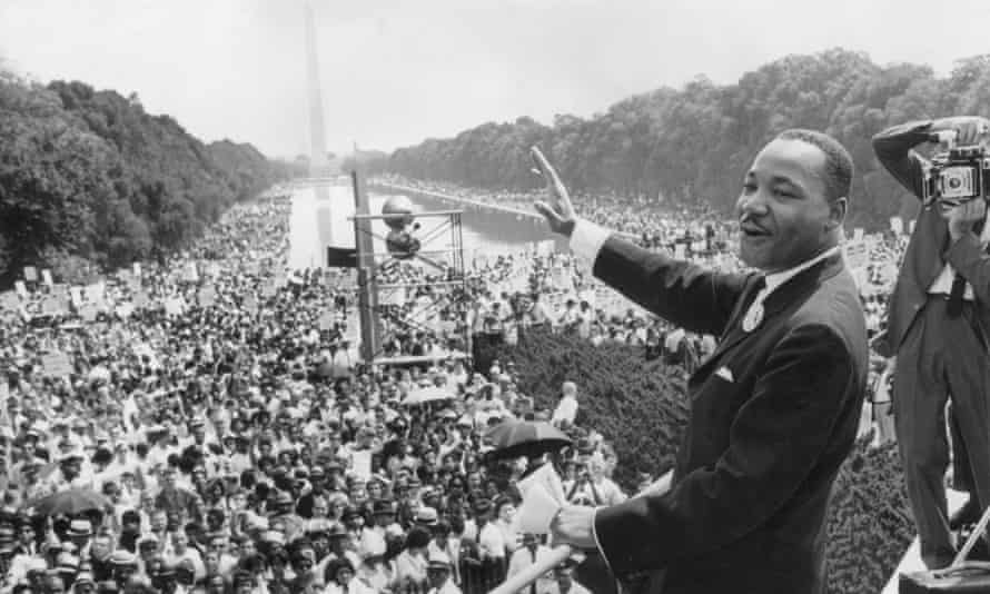 Martin Luther King standing before the crowd at the Lincoln Memorial, 1963