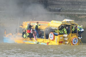 Duck boat fire: Passengers cling to the outside of the amphibious vehicle