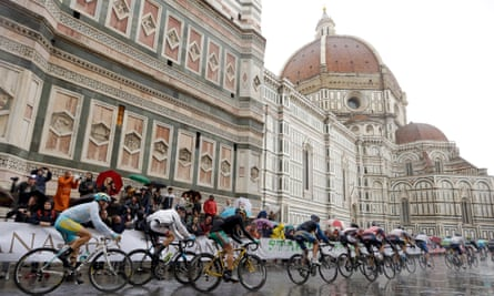Cyclists ride through a soggy Florence during the men's elite race, at the road cycling world championships.