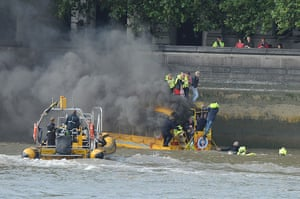 Duck boat on fire: Passengers are rescued from the roof of the amphibious vehicle