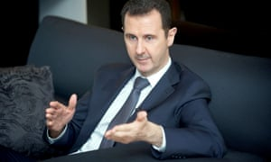 Syrian President Bashar al-Assad speaking during an interview with French news paper Le Figaro in Damascus.