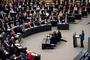German Chancellor Angela Merkel (R) makes a speech during the final session before the elections of the Bundestag, the lower house of Parliament,  in Berlin on September 3, 2013.