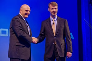 Microsoft chief executive officer Steve Ballmer (left) shakes hands with   Nokia Chairman an interim chief executive Risto Siilasmaa to seal their acquisition of Nokia's mobile phone business in a euros 5.44 billion deal, at a press  conference in Dipoli congress center in Espoo, Finland  03 September 2013.