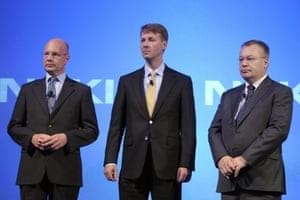 Standing together are, left-right, Nokia's new CEO Timo Ihamuotila, left, Chairman of the Board Risto Siilasmaa, and former CEO Stephen Elop, during the press conference of the Finnish mobile manufacturer Nokia in Espoo, Finland on Tuesday, Sept. 3, 2013.