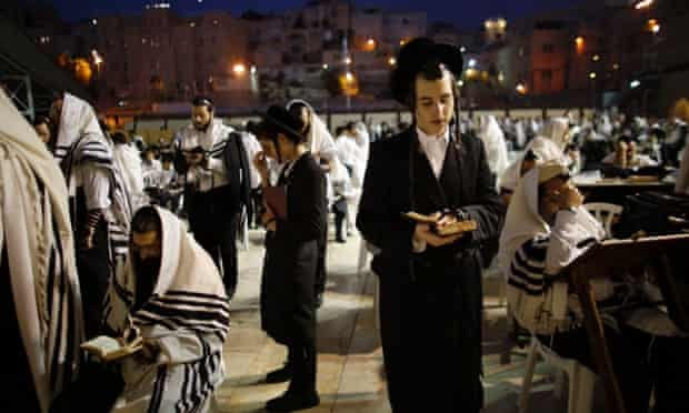 Worshippers pray at the Western Wall, Judaism's holiest prayer site, ahead of Rosh Hashanah, the Jewish New Year.