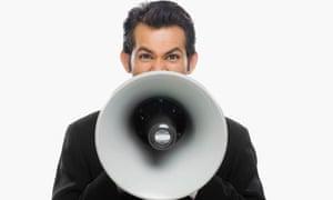 Man shouting into a megaphone