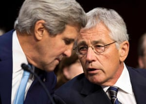 John Kerry, U.S. Secretary of State (L), and Chuck Hagel, Secretary of Defense, speak before presenting the administration's case for U.S. military action against Syria to a Senate Foreign Relations Committee hearing in Washington September 3, 2013.