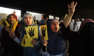 Members of the Muslim Brotherhood and supporters of ousted Egyptian president Mohamed Morsi shout sl