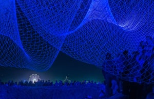 Glow Santa Monica: Visitors explore The Space Between Us by artist Janet Echelman