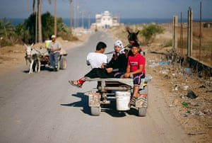 Young newlyweds: The newlyweds ride on a donkey cart on the way to Gaza's beach two days aft