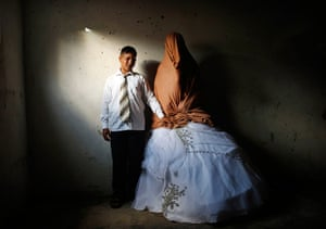Young newlyweds: Palestinian groom Ahmed Soboh, 15, and his bride Tala, 14, stand inside Tal