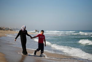 Young newlyweds: The couple walk on the beach two days after their marriage