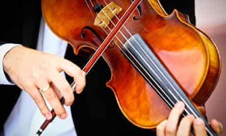 A musician plays a viola