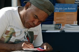 Carlos Chavez fills out an information card during an Affordable Care Act outreach event hosted by Planned Parenthood for the Latino community in Los Angeles, California September 28, 2013.