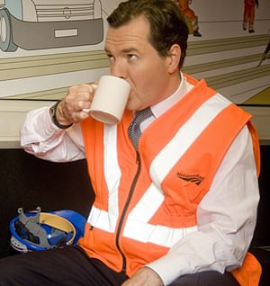 Hi-vis Osborne: George Osborne drinking tea from a mug during a visit to Swindon, Wiltshire