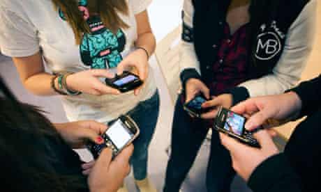 Students using blackberry telephones