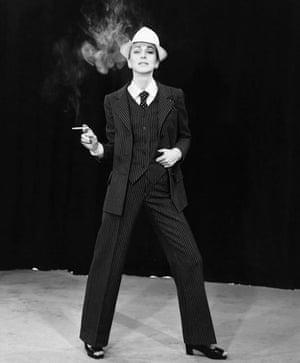 Model wears pinstripe trouser suit by Yves Saint Laurent, 1967