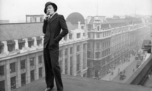 Model wears the Marlene Dietrich fashion of tailored man's suit on rooftop above Regent Street, 1933