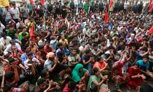 Bangladeshi garment workers shout slogans during a protest in Dhaka, Bangladesh.