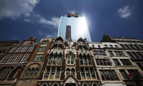The sun glares down from a new office building in the the City of London. The concave side wall of the 37-storey skyscraper at 20 Fenchurch Street, known locally as the 'Walkie Talkie' building, has been blamed for reflecting intense sunlight and heat on to the street below.