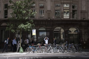 Walkie scorchie: City workers walk past bicycles in Eastcheap
