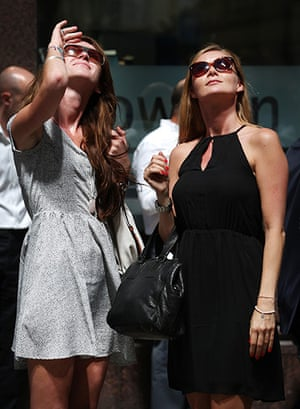 Walkie scorchie: Women look up as the sun is reflected down