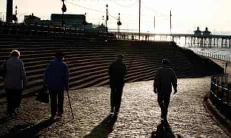 Pensioners walk along the front in Blackpool