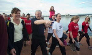 The Prime Minister Kevin Rudd walks around lake Burley Griffin in Canberra this morning with local candidates, members and senators.
