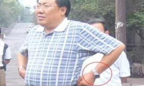 Yang Dacai wearing one of his collection of expensive wristwatches