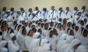 Roman Catholic nuns attend a service to commemorate the 16th anniversary of the death of Mother Teresa at her tomb in the Missionaries of Charity house in Kolkata.