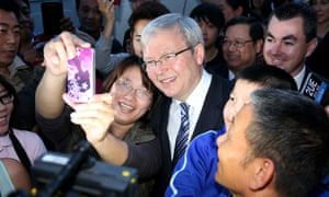 Say cheese: Australian Prime Minister, Kevin Rudd poses for photos with voters in Western Sydney. After spending the morning in Canberra Kevin Rudd addressed the National Press Club, in what may be his final time as Prime Minister. The Australian Labor Party failed to gain in the polls in the five-week campaign and looks set to lose government on Saturday.