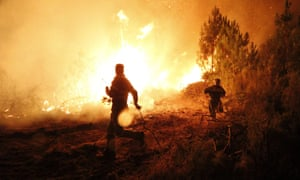 Flames rage through a forest during a fire in Palas del Rei in Galicia, Spain. The fire has already affected the towns of Palas de Rei and Melide. Three forest fires are still burning land while five others are now under control in Galicia region.