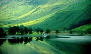 Early autumn reflections in Crummock Water in the Lake District in Cumbria, as another scorching September day will greet parts of England and Wales today before the summer heats turns to downpours.