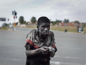 Pieter Hugo - Kin: At a traffic intersection, Johannesburg, 2011