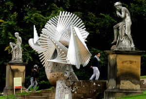 Visitors walk past Ivy by Manolo Valdés at Chatsworth House.