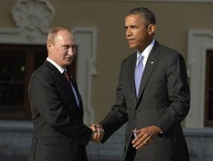 Awkward? President Vladimir Putin welcomes US President Barack Obama at the start of the G20 summit in St Petersburg.