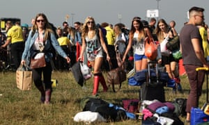 Here come the girls. Festival goers arrive on day one of Bestival, at Robin Hill Country Park on the Isle of Wight.