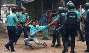 Police baton charge a Dhaka University's student during a protest in Dhaka. Clashes erupted after several students were beaten up by activists of Bangladeshi political party Awami League and Sramik League.
