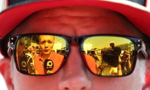 A reporter is reflected in the sunglasses of Kimi Raikkonen during preparations for the Italian Grand Prix in Monza.